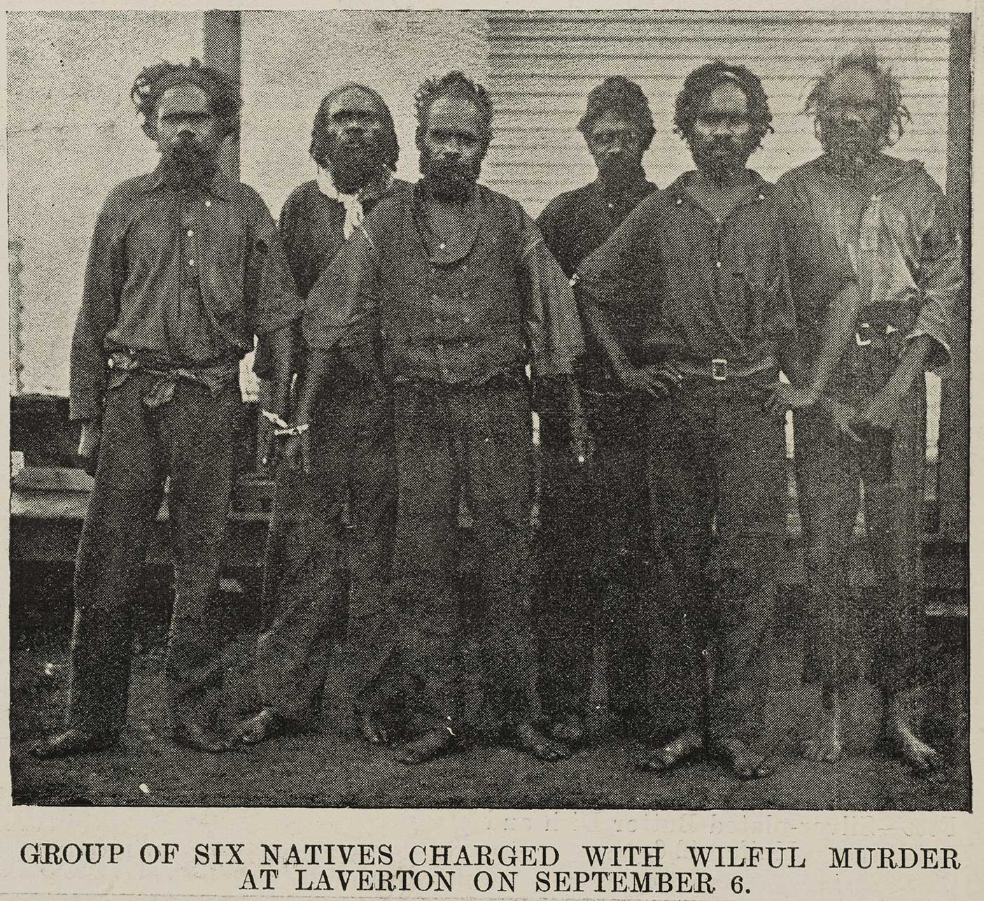 Group of Aboriginal men from the North-east Goldfields in chains, awaiting trial in Kalgoorlie