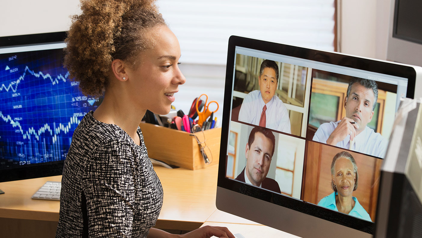 A women teleconferencing on a computer