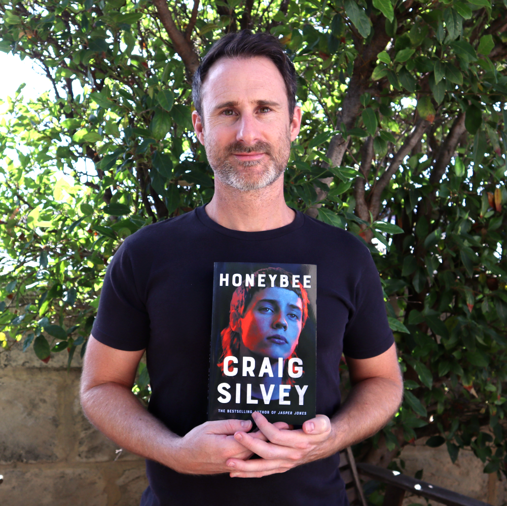 Craig Silvey, holding a copy of 'Honeybee'. Photo by Craig Silvey.