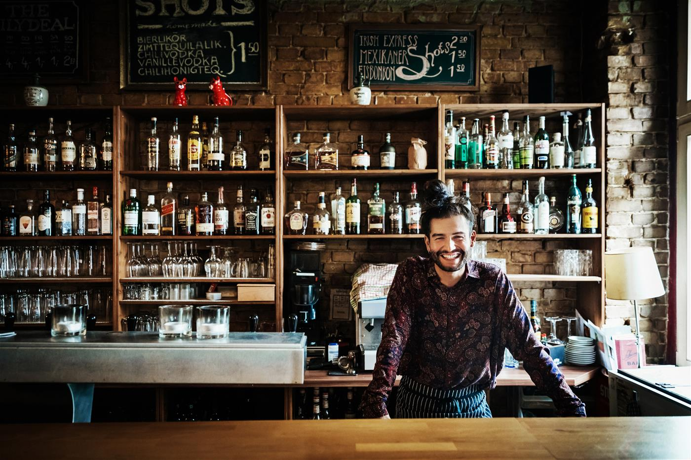 Bartender smiling behind the counter