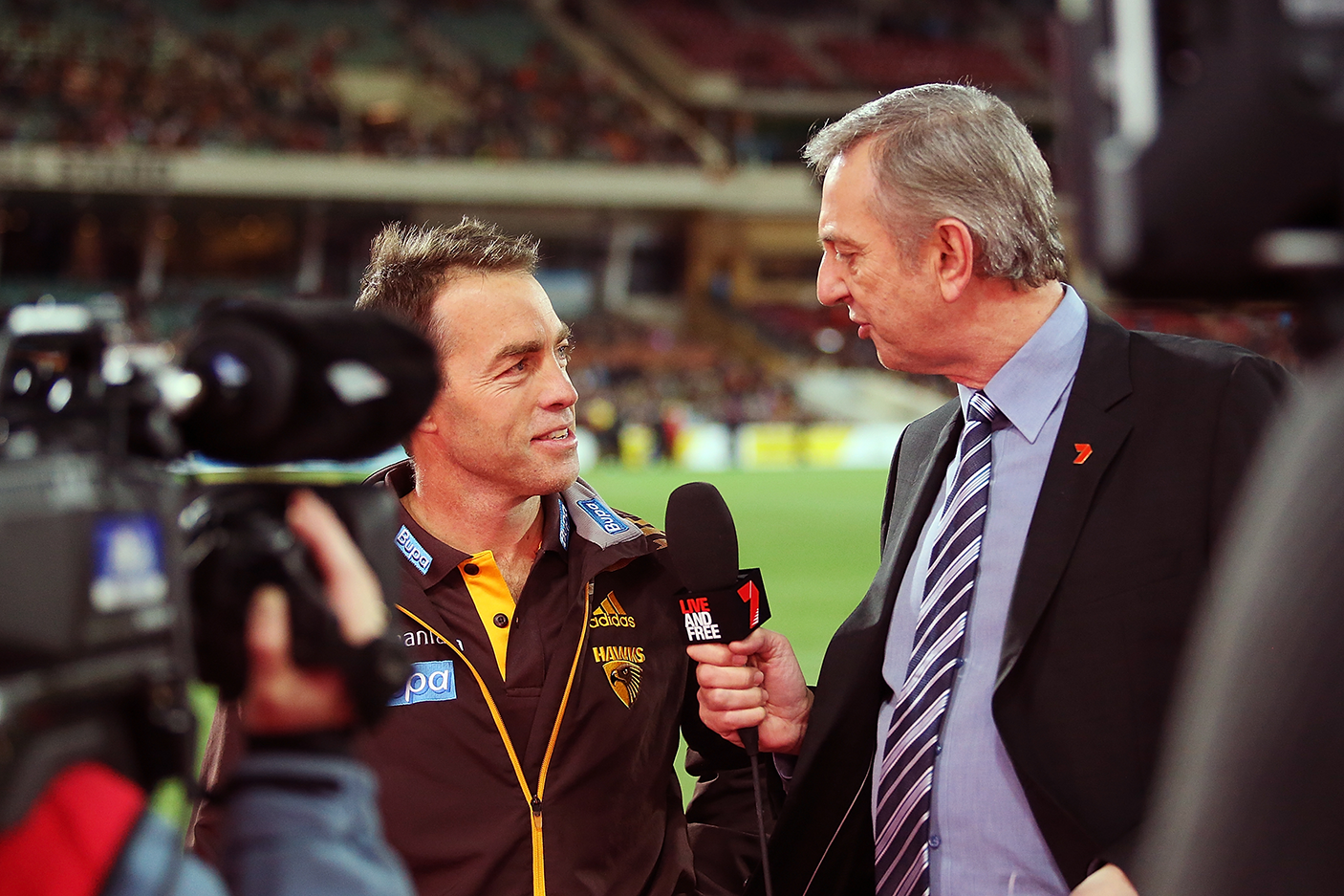 Alastair Clarkson of the Hawks is interviewed by Dennis Cometti before the round 17 AFL match