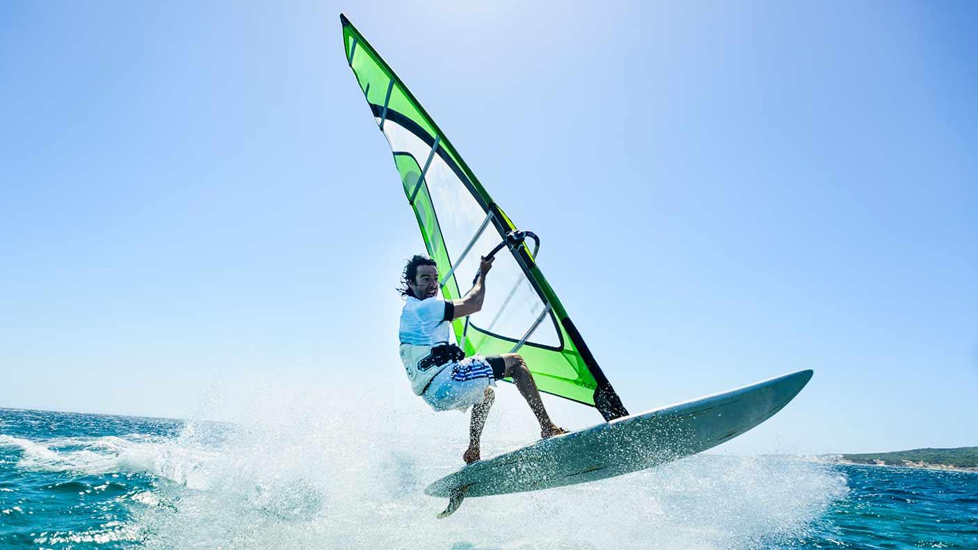 A man windsurfing. Credit: Ben Welsh Getty Images