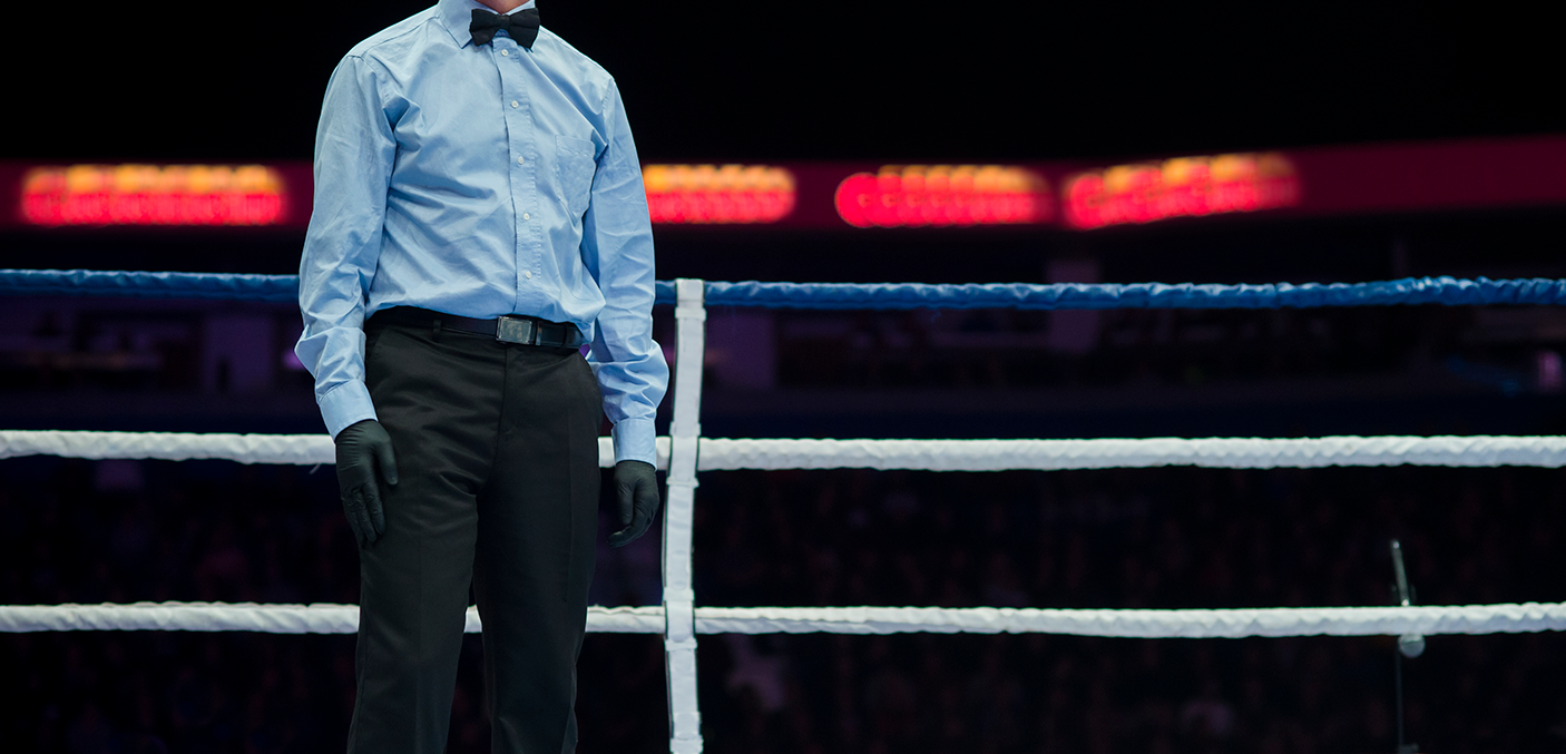 Midsection Of Referee Standing In Boxing Ring - stock photo