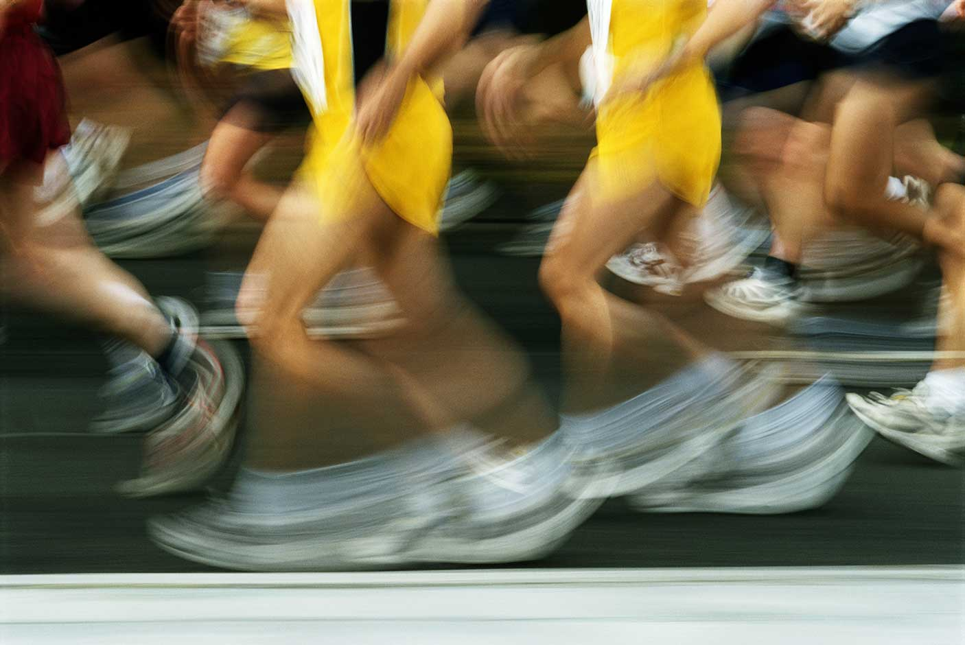 Runners together in a group with motion blur