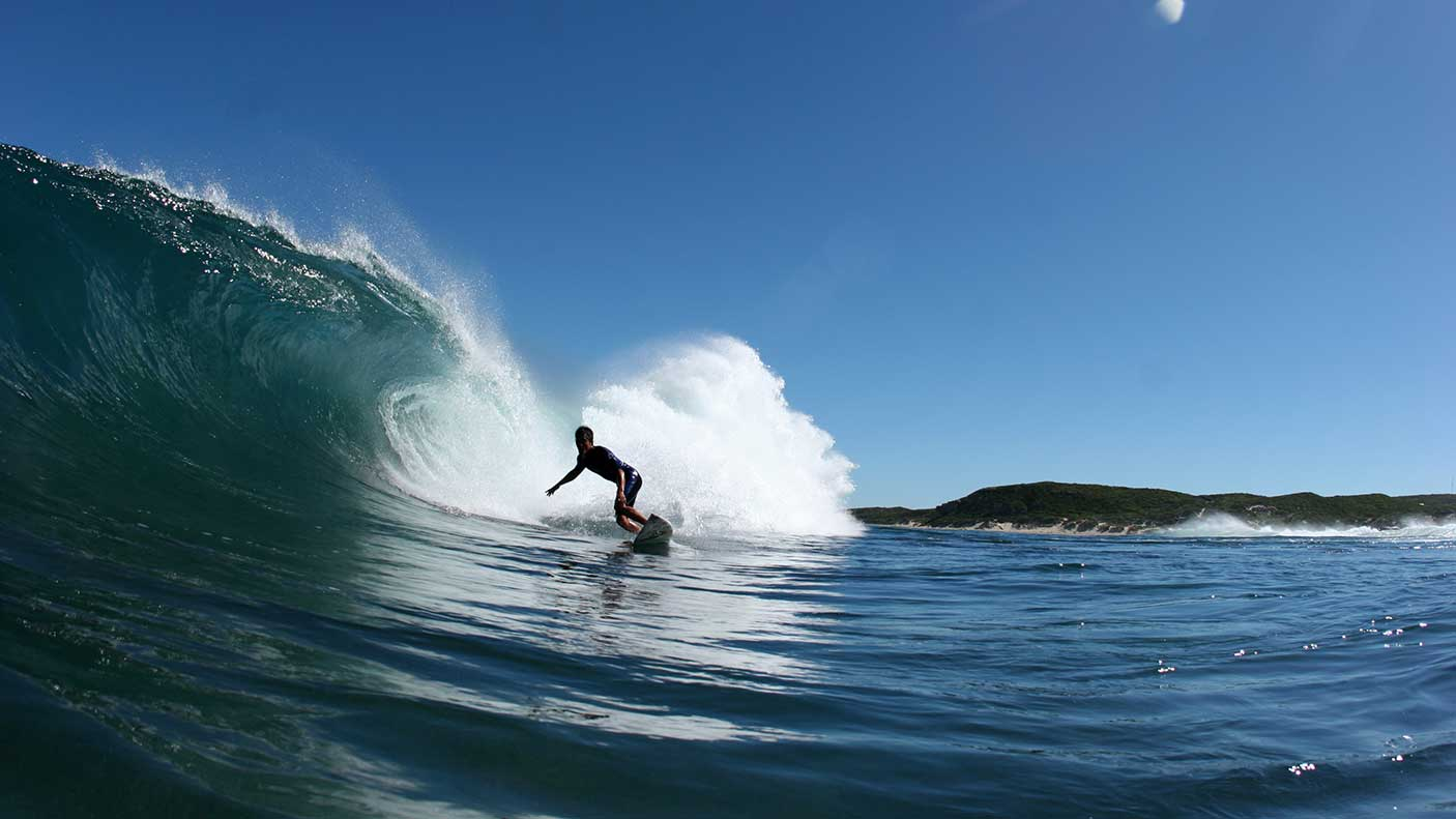 Surfer sets up for the tube in Western Australia