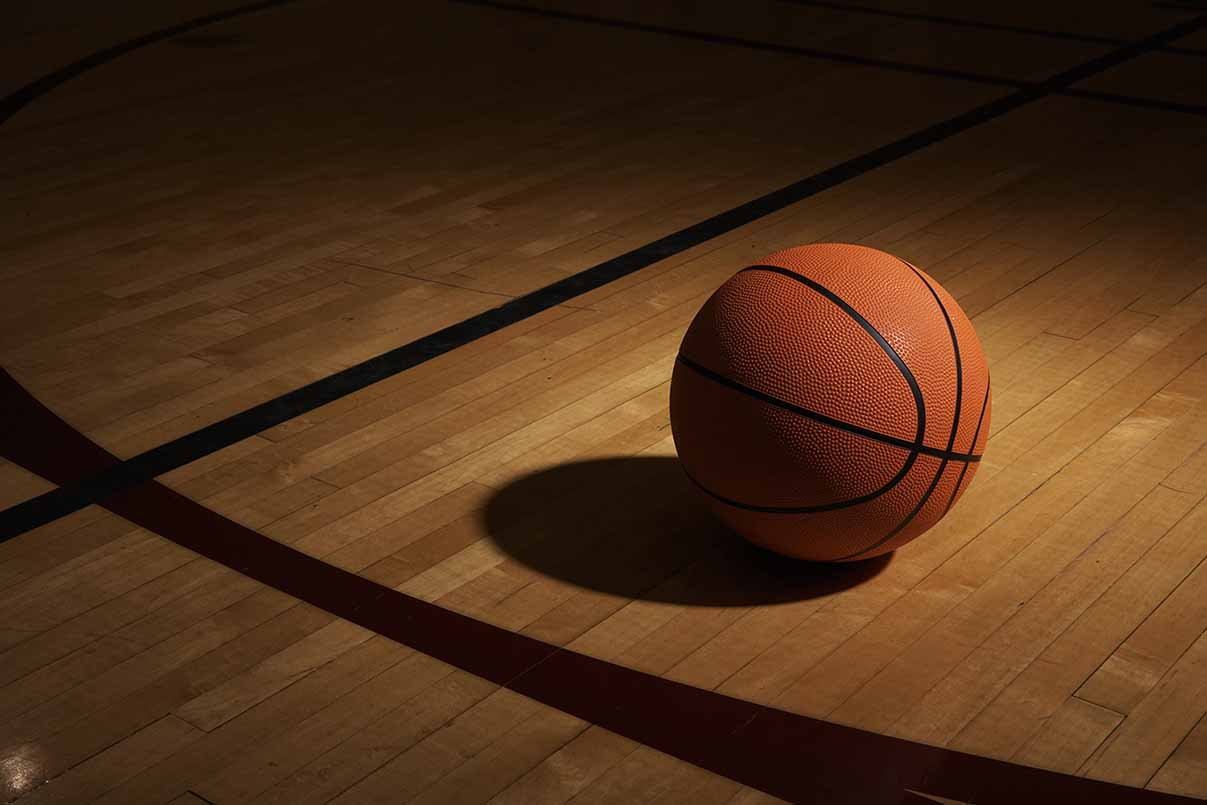 Stock image of a basketball on a court. Getty Images.