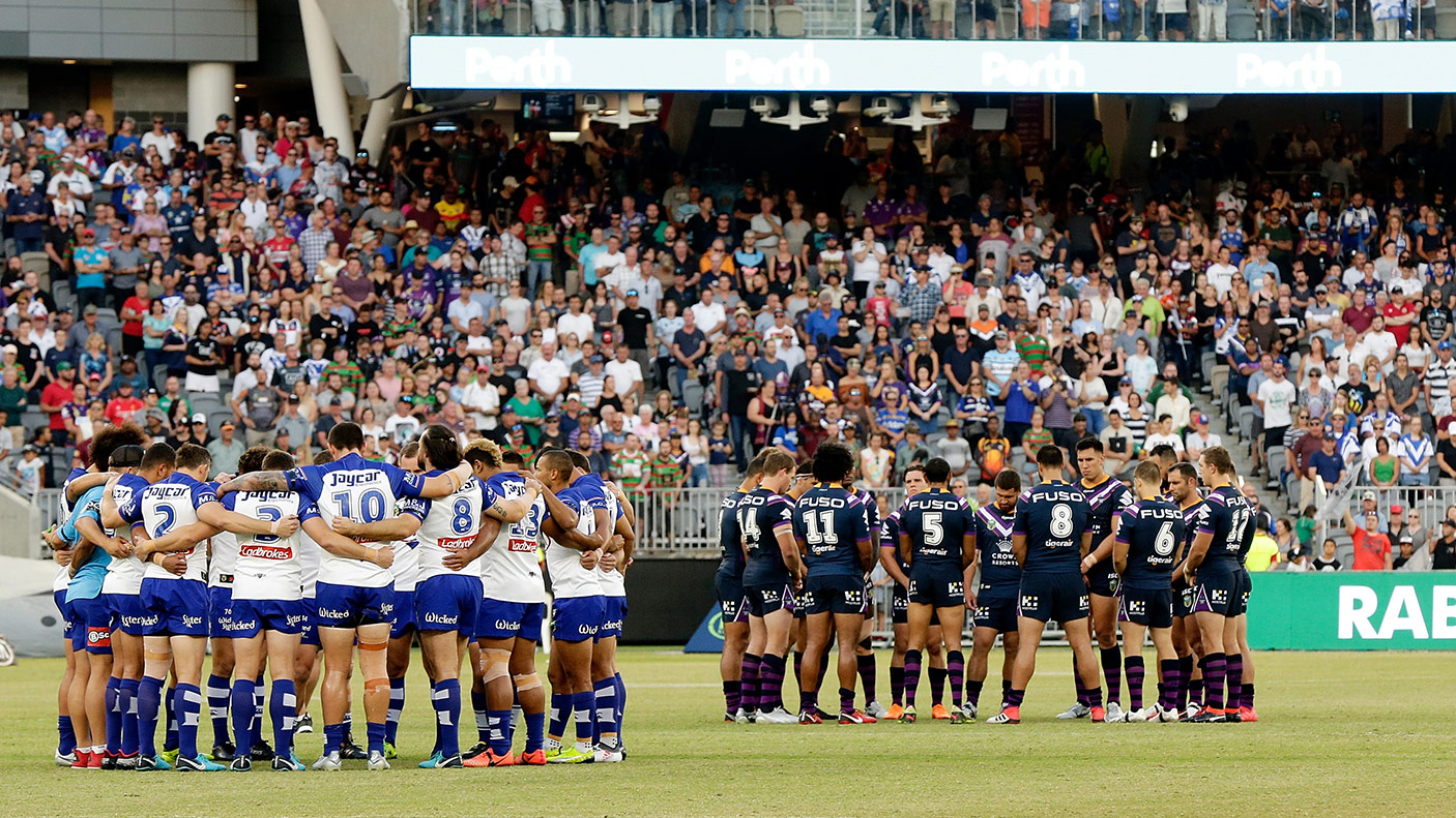 The Bulldogs and Storm players form a huddle in memory of Steve Folkes during the round one NRL match between the Canterbury Bulldogs and the Melbourne Storm at Perth Stadium on March 10, 2018 in Perth, Australia. (Photo by Will Russell/Getty Images)