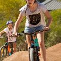 A girl on a bike on the pump track